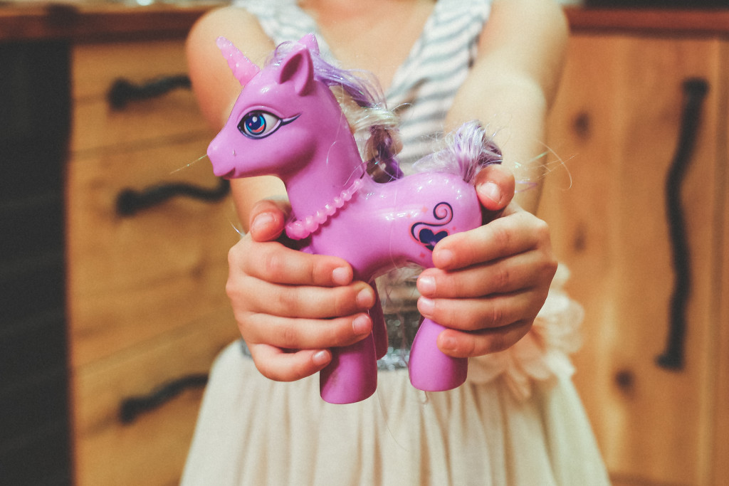 kaboompics.com_Child_holding_unicorn_toy